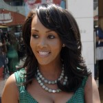 Vivica A Fox waves hello as she heads to her car after shopping at the trendy H Lorenzo store